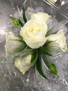 Wristlet corsage with white spray roses, silver mesh ribbon, clear rhinestones…