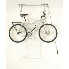 A high ceiling in a back hall is a great place to store a bicycle, using a hoist.