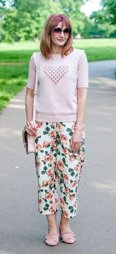 b507c7b45d1 Blush pink summer outfit  Pink sweater with heart motif   cropped floral  trousers pants