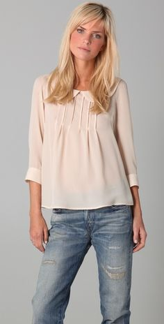 refined top with slouchy jeans