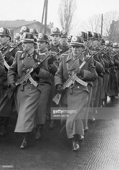 Officers of the East German Volkspolizei, equipped with StG 44 assault rifles, parading through the streets of East Berlin, East Germany, circa