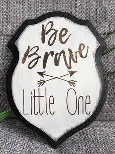 A personal favorite from my Etsy shop https://www.etsy.com/listing/506925343/boy-nursery-shield-sign-be-brave-rustic