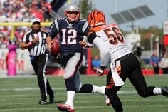 Foxborough, MA - 10-16-16 - Tom Brady under pressure by Bengal Karlos Dansby in 1st quarter action. Gillette Stadium Cincinnati Bengals at New England Patriots - 1st quarter action. ()