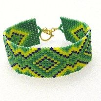 """Beaded Cuff Bracelet, Tribal, Ethnic, Southwestern Hand beaded using the square stitch technique one bead at a time. Fireline bead thread for strength and durability. Glass seed Beads Gold Tone Toggle Clasp Gold Tone Thread Protectors Fits 7 1/4"""" Wrist 1"""" Wide Makes A Nice Gift-Comes In A..."""