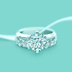 The Tiffany® Setting engagement ring with a shared-setting diamond band ring. #TiffanyPinterest #WeddingBand