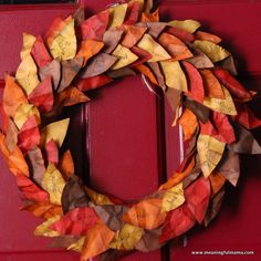 Thanksgiving Wreath with Paper Leaves - This Beautiful Door Wreath was made by kids. Each paper leaf is antiqued with a stamp pad with things they are thankful for. Easier than it looks. Meaningful Mama