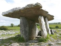 "Poulnabrone Dolmen (Poll na mBrón in Irish meaning ""hole of the quern stones"" (bró in Irish)"") is a portal tomb in the Burren, County Clare, Ireland, dating back to the Neolithic period, probably between 4200 BC to 2900 BC. Stonehenge, Cairns, Le Taj Mahal, Clare Ireland, Antrim Ireland, Dublin Ireland, Ireland Travel, Travel Europe, County Clare"