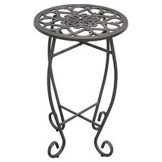 """Planter stand with cast iron top.  Product: Planter standConstruction Material: Cast iron top and steel tubing legsColor: IronFeatures:  Folding legs for easy assembly and storagePowder-coated finish Dimensions: 18"""" H x 14"""" Diameter"""