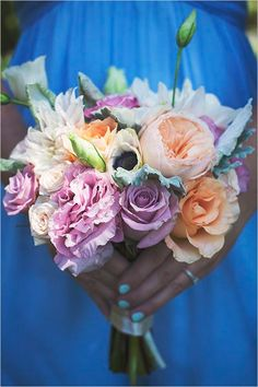Colorful bridesmaid bouquet. Floral Design: Blossoms By Lisa ---> http://www.weddingchicks.com/2014/06/09/dog-gone-darling-wedding/