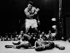 Muhammad Ali reacts after his first round knockout of Sonny Liston during the 1965 world heavyweight title fight.