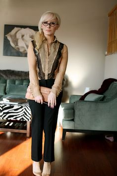 Black ankle pants, nude and black lace blouse, clutch, work outfit