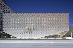 The white, porous façade of the Broad Museum in Los Angeles allows the building's sculptural, futuristic interior to be bathed in natural light.