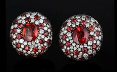 Michele della Valle, A fine pair of hessonite garnet and diamond cluster earrings