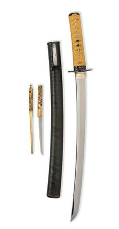 A JAPANESE WAKISASHI   THE BLADE SIGNED JUMYO, THIRD QUARTER OF THE 17TH CENTURY   With polished single-edged blade of traditional form and construction, the hilt with later fuchi kashira decorated with guri scrollwork, and cord-bound shagreen-covered grip, in black ribbed scabbard with matching kodzuka and kogai  18 3/8in (46.2cm) blade