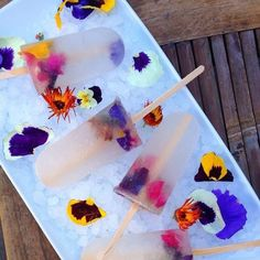 edible flower popsicles could be awesome for summer...especially swapping the liquer for Soho Lychee. this is happening