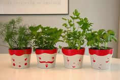 Cute!  The pots look like tomatoes with faces.