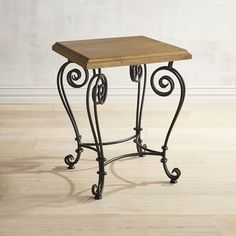 With a flirty yet graceful demeanor and a handsome yet traditional elegance, our end table is evidence that a split personality can be a good thing. The intricately scrolled legs and base are made of hand-forged wrought iron and support a nicely finished mango wood top. Perky enough to stand out yet coy enough to mingle easily with your other furnishings, this table will be good therapy for your home.