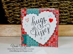 Wizard's Hangout: 3x3 Valentine's Cards: Hugs & Kisses: Paper: Heartstrings; White Daisy CS; Blue Glitter paper Stamps: Doodled Designs, XOXO Inks: Black, Cranberry, Lagoon Embellishments: Red Enamel Heart, Clear and Bitty Sparkles Other: Scalloped Heart punch (Marvy Uchida), 3D foam tape