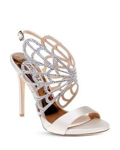 Badgley Mischka evokes the grace of a butterfly in this whimsical winged cage sandal dotted with shimmering crystals. | Satin upper, leather lining, leather sole | Imported | Fits true to size, order