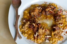 hot pumpkin pie oatmeal with pecans and crumbled pumpkin pie squares  {Oh She Glows}