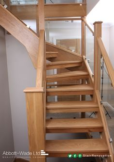 Open oak tread with glass balustrade.