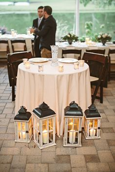 Sweetheart table lanterns.  Tre Bella Events. Photography: Almond Leaf Studios - www.almondleafstudios.com  Read More: http://www.stylemepretty.com/north-carolina-weddings/2013/12/24/oaks-at-salem-wedding/