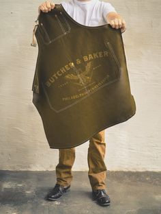 About This Item: This rustic selvage denim apron is constructed of waxed cotton denim and is printed with the Butcher & Baker logo on the front lap pocket. Apro