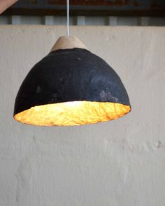 Paper pulp light by Quazi Design, handmade in Swaziland from waste magazine paper
