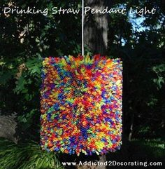 Make a light out of drinking straws! I would use just one colour though to accentuate the texture of it.