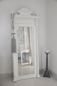 Large White Floor Mirror - with wide trim moldings and lots of details that give it so much character - via The Old School