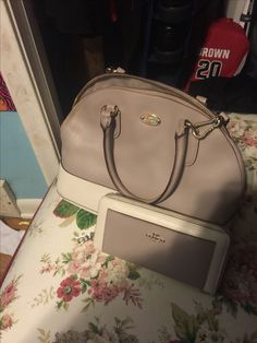 Coach purse and wallet set. Asking 155 shipped. Yes that is the lowest.