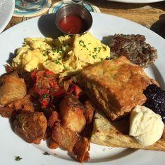 , Kraftwork Breakfast (Eggs, Potatoes, Sausage, and Biscuit).