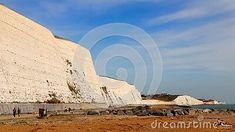 people-walking-walkway-under-white-chalk-cliffs-sussex-south-england-bright-blue-sky