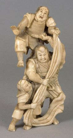 A Japanese carved ivory okimono of three Samurai warriors: attempting to climb a wall, signed , Meiji period, 16.5cm. high.