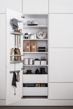 All white kitchen closet organization by SieMatic.