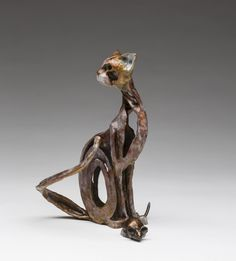 A Gift by Sandy Graves. This charming feline is proud to present its latest catch - a treat every cat lover knows well! The artist uses negative space and fluid form to capture a cat's inquisitive personality and agile grace with a dash of gentle humor. Cast bronze. Limited edition of 100. An Artful Home exclusive.