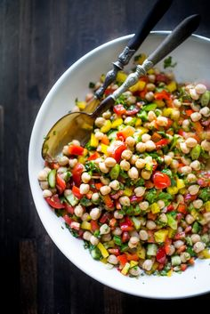 Balela Salad   <   Made w. finely chopped vegetables, chickpeas, fresh herbs, lemon & olive oil. Serve in a pita with tahini sauce or over greens   /   FaH