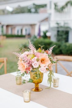 Peach flowers with pears: http://www.stylemepretty.com/2014/04/23/pink-peach-backyard-charleston-wedding/ | Photography: Shannon Michele -  http://shannonmichelephotography.com/