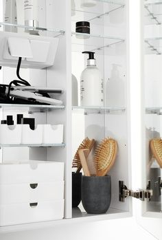 Mirror cabinet with shaver point and lots of storage in funcional trays.