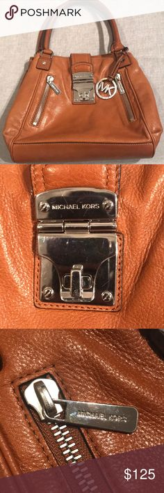 Michael Kors cognac brown soft leather purse Michael Kors cognac brown soft leather shoulder handbag purse satchel with brass hardware and multi zippers and pockets inside..  (GUC) has a couple ink mark stains inside pocket (see pic) Michael Kors Bags Hobos
