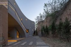The in-situ concrete walls also incorporate small cutouts shaped to echo the forms of buildings in the Miniature Series. Concrete Forms, Concrete Walls, Axonometric View, Derelict House, Rammed Earth Wall, Chinese Architecture, Old Buildings, Abandoned Houses, Atelier