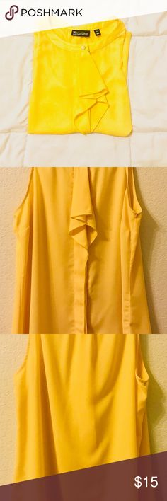 7th Avenue New York and Company Yellow blouse 7th Avenue New York and Company Yellow blouse  Short Sleeve with ruffle in the middle.  Has 2 signs of wear (last 2 pictures provided) New York and Company Tops Blouses
