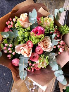A beautiful hand-tied bouquet of flowers with pink hypericum, roses, ranunculus, green/grey eucalyptus with a splash of lime viburnum. Beautiful Bouquet Of Flowers, Beautiful Flower Arrangements, Flowers Nature, Floral Arrangements, Beautiful Flowers, Wedding Flowers, Wild Flowers, Flor Iphone Wallpaper, Luxury Flowers
