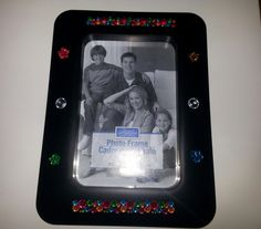 Check out this item in my Etsy shop https://www.etsy.com/listing/212704007/hand-decorated-jeweled-picture-frame