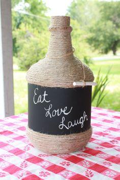 Chalkboard painted wine bottle • Materials: Wine bottle, Twine, Glue, chalkboard paint