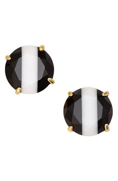 A bold white stripe adds a contemporary twist to these Kate Spade earrings.