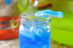 Blue Shark Attack Cocktail by Mooshu Jenne Blue shark attack cocktail containing rum pineapple juice blue curacao and gummy sharks. Curacao Drink, Blue Curacao, Liquor Drinks, Mix Drinks, Party Drinks, Beverages, Shark Week Drinks, Alcoholic Punch, Alcholic Drinks
