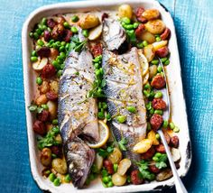 Bake whole sea bass with white wine, lemon and chorizo to make a delicious sauce that soaks into the tender new potatoes