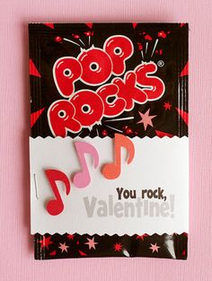 You Rock    These go together very quickly and are always a hit with the kids!    1. Create text box twice the width of candy and tall enough to cover up all of the miscellaneous cover text.  2. Add text as shown and print. Trim edges with pinking edgers or shears.  3. Fold around wrapper and staple at side seam so you do not disturb candy inside.  4. Add three music note punches randomly.