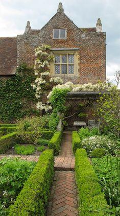 Herringbone paving and box hedging at Sissinghurst Castle, Kent, England by Susan Rushton